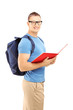 Smiling male student with backpack reading a book