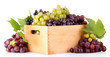 assortment of ripe sweet grapes in wooden crate, isolated