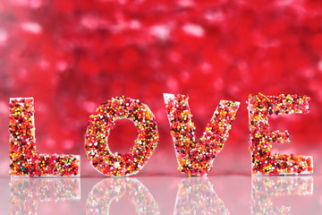 "Word ""Love"" on red background"