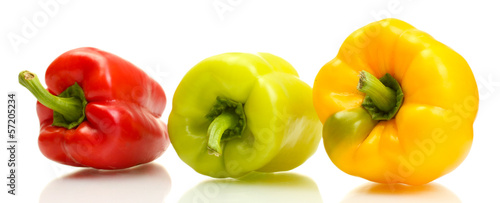 fresh yellow, red and green bell peppers isolated on white
