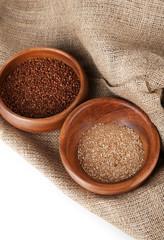 Buckwheat and flour in bowls closeup