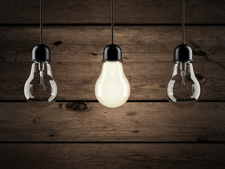 unique bulb on wooden background