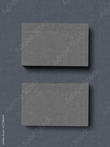 two stacks of grey business cards