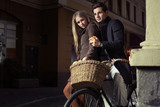Great couple riding oldfashion bicycle poster