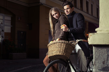 Great couple riding oldfashion bicycle