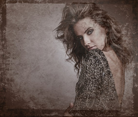 Retro styled grunge portrait of young beautiful woman.