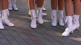 White boots on nice legs of cheerleaders
