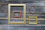 various picture frame on old wooden wall