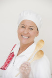 Woman in cook workwear happy smiling poster