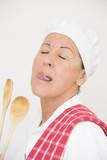 Woman in cook workwear gourmet tasting poster