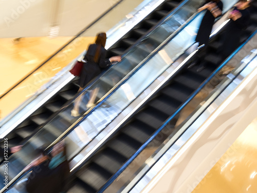 Business people walking on escalator