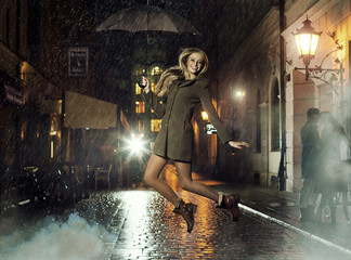Fantastic photo of attractive girl jumping in heavy rain