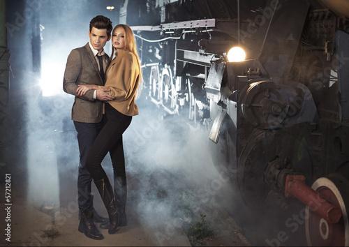 Elegant couple at the railway station
