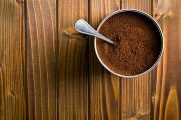 ground coffee in metal jar