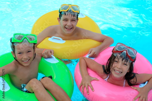 Happy kids in swimming pool
