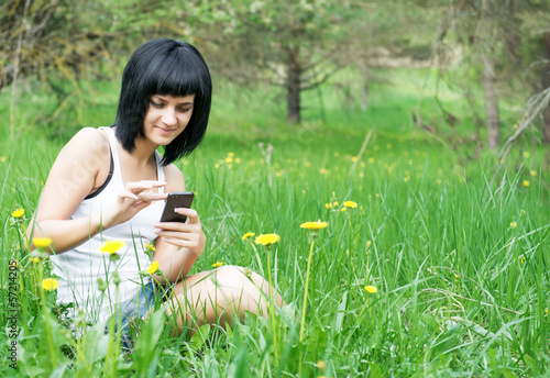 Woman enjoying the outdoors using her cell phone