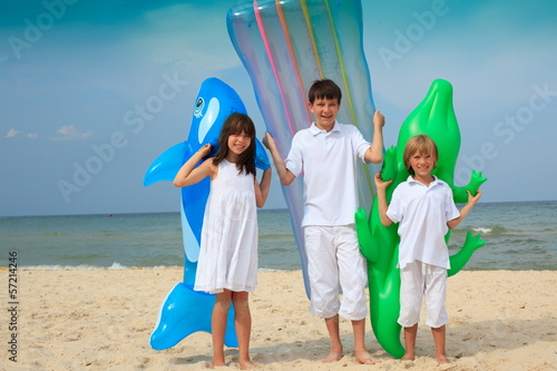 Children on beach with inflatables