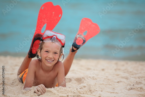 Boy on beach with flippers