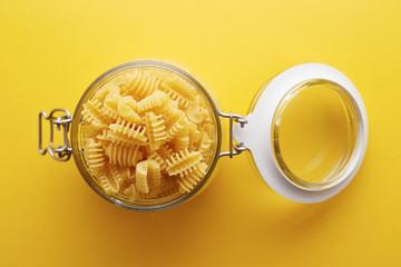 Raw radiatori pasta on a glass jar