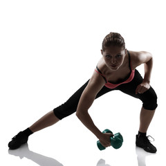 sport young athletic woman lunges with dumbbells, silhouette