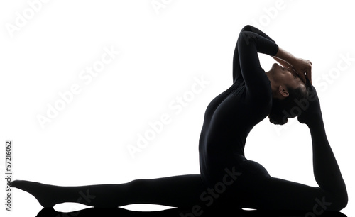 woman contortionist  exercising gymnastic yoga   silhouette - 57216052