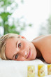 Blonde smiling woman relaxing on massage lounger