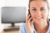 Close up of a businesswoman making a phone call