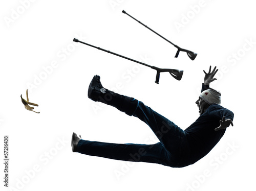 injured man with crutches slipping silhouette