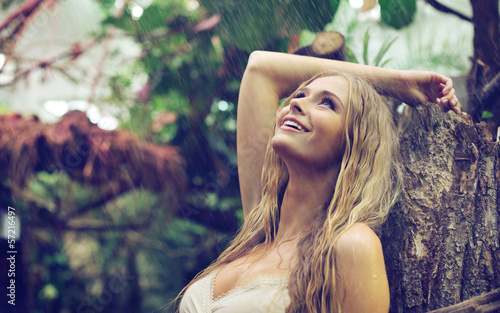 Amazing woman enjoying warm rain - 57216497