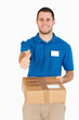 Smiling young salesman with packet giving thumb up