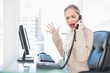 Furious blonde businesswoman screaming on the phone
