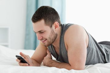 Young man using his mobile phone