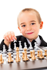 Little kid opening chess game