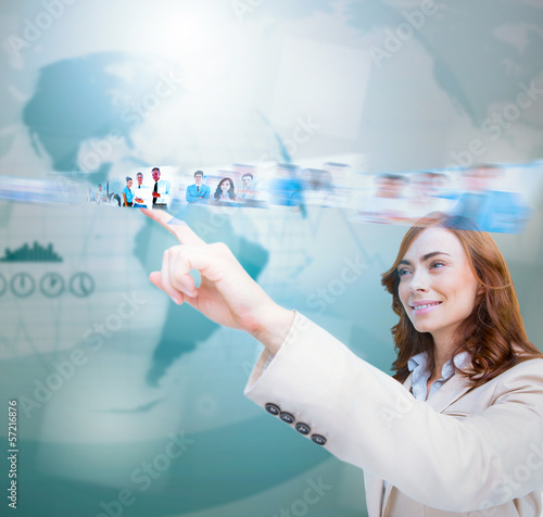 Smiling businesswoman scrolling pictures