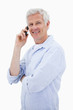 Portrait of a happy man making a phone call while looking at the