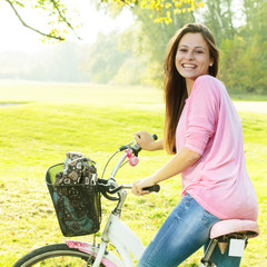 Happy student girl with bicycle