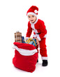 Little Santa boy with gift bag