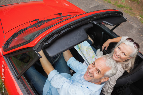 High angle view of cheerful mature man having a ride with his wi