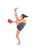 Pretty sporty brunette kick boxing
