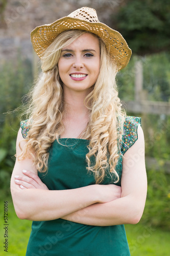 Pretty woman wearing a straw hat
