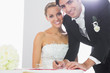 Happy bridegroom signing wedding contract