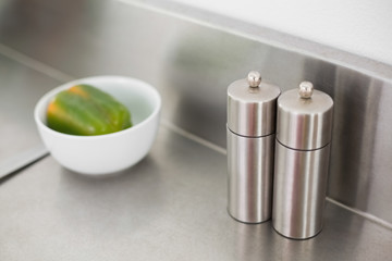 Salt and pepper on a chrome counter