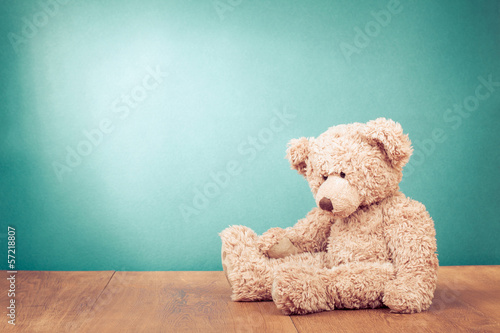 Tuinposter Retro Teddy Bear toy alone on wood in front mint green background