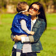 Portrait of fashionable baby boy and his gorgeous mother