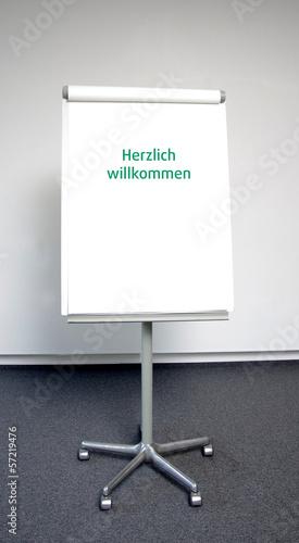 """""""Herzlich willkommen"""" in grüner Schrift"""