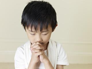 little asian boy making a wish