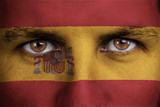 spain, spanish flag painted on the face of young man