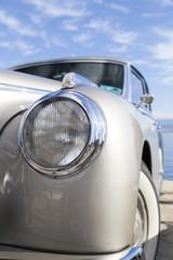 Vintage car details lights and grille, close-up