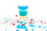 short blue coctail with ice and color drops