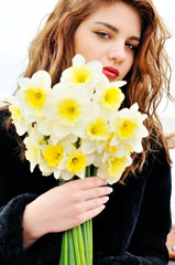 teen girl with daffodils